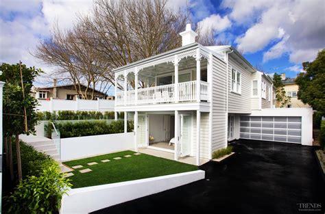 Log Garage Designs classic villa exterior meets contemporary interior in this
