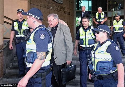 neck tattoo police police officer flanking cardinal george pell sports neck