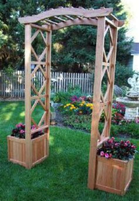 Arbor With Planters by Walk Through Arbor With Benches Planters Yard Ening