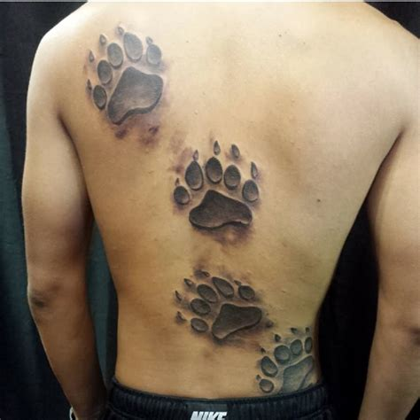 tattoo pictures bear paws bear claw prints tattoos on back pinteres