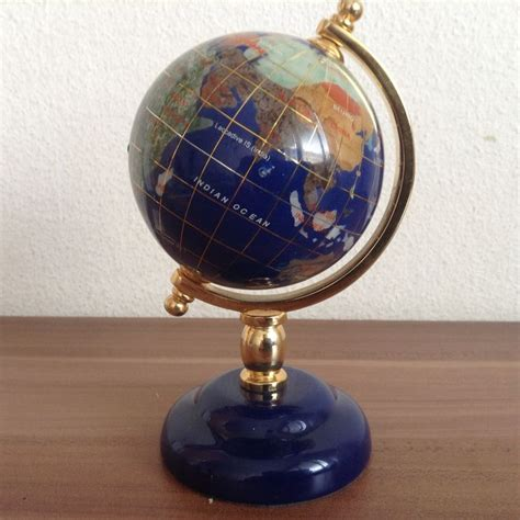 rotating lapis lazuli globe with other gems and pearl