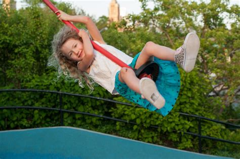 baby in swing all night playgrounds brooklyn bridge park