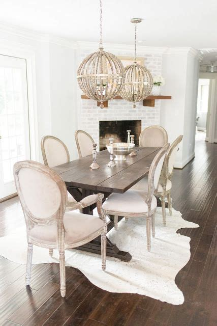 a chandelier and a cow hide rug sew a fine seam 1000 ideas about dining room inspiration on pinterest