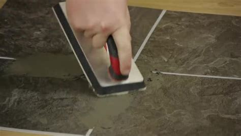 how to lay self stick tile around a toilet ehow video how to use groutable peel stick floor tile ehow