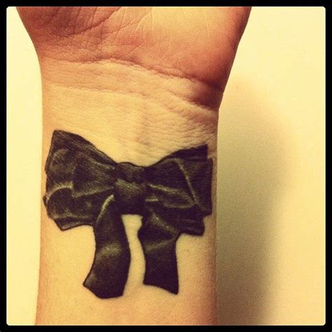 bow tattoo on thigh bow ideas