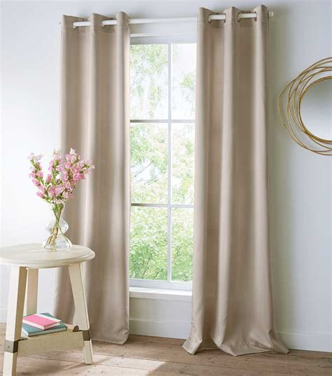hanging drapery panels how to hang grommet curtains