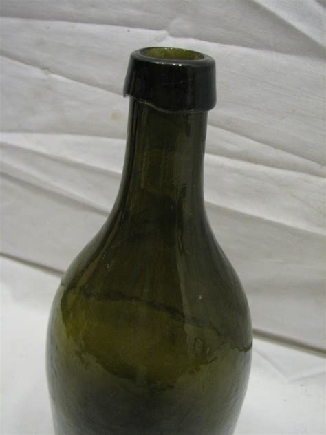 antique glass ls antique carlsbad ls bitters alcohol olive green glass