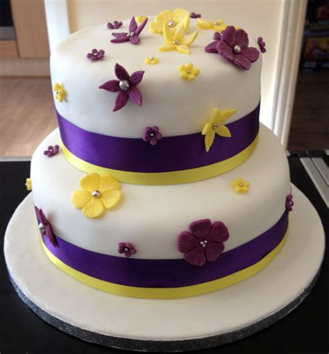 Wedding Cakes With Yellow And Purple Flowers by Purple Yellow Wedding Cake Say It With Flours