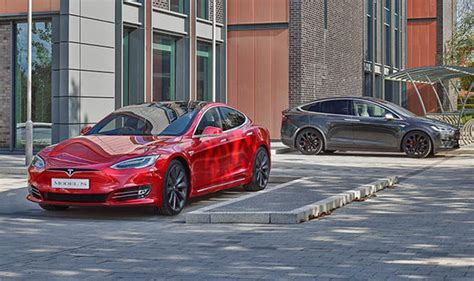 tesla model   model  receives price cuts  top