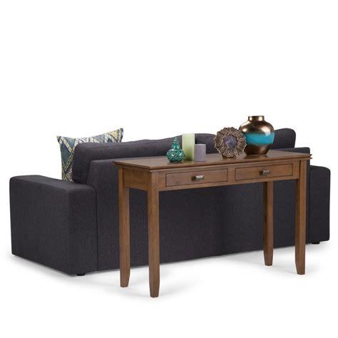 simpli home artisan medium storage simpli home artisan medium saddle brown storage console