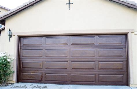 How To Stain A Metal Garage Door by Diy Garage Door Makeover With Stain Domestically Speaking