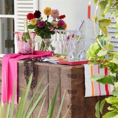 The Olive House Partisi garden drinks station with storage trunk and pink