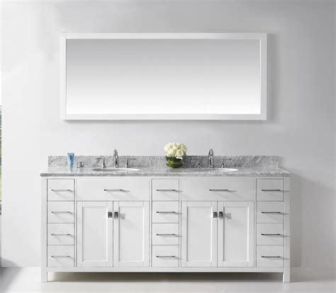 white bathroom vanity and powder space traba homes