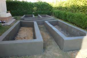 Raised Garden Bed On Concrete Patio by Raised Garden Bed Made Of Block And Covered With Concrete