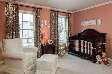 warm peachy rose walls contrast   dark wood crib