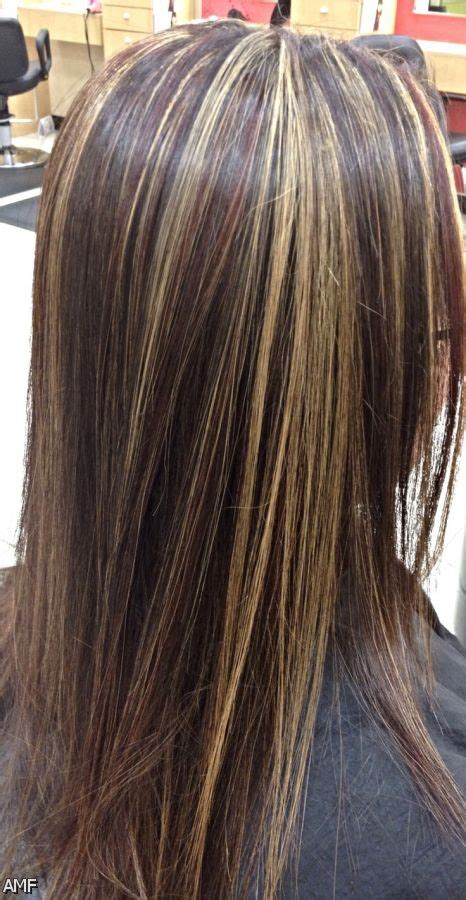 what is popular in hair colour for 2015 dark brown hair with blonde highlights and red lowlights