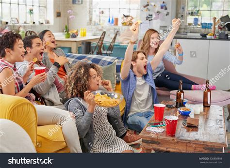type of sport that fans watch on tv on thanksgiving people watching football on tv pictures to pin on