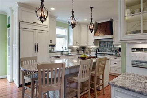 traditional kitchen with eat in island and wrought iron