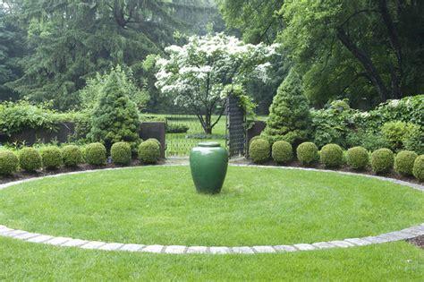 Design Classics Home Garden Inc by Classic Urn In A Courtyard Garden