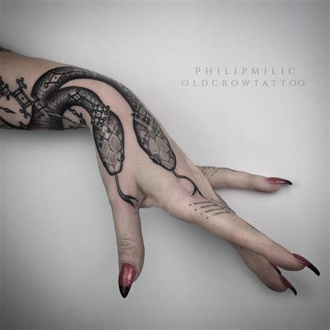 tattoo on hand snake snakes on womans hand best tattoo ideas designs