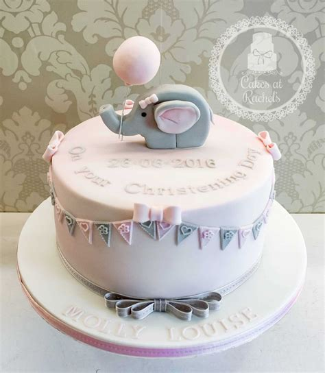 elephant christening cake decorated with pink and
