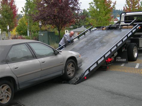 tow truck bed 10 things to know before having your car repaired in