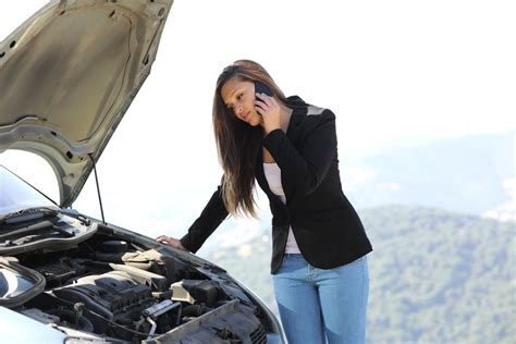 woman driver on the phone for car breakdown keeping your car longer with a used car warranty