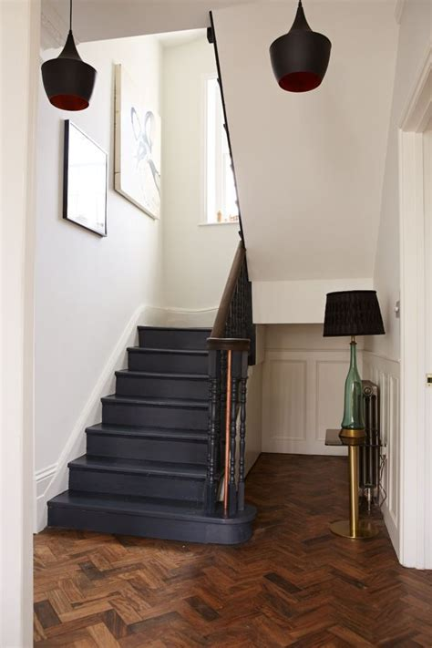 wood plank tile on staircase with white painted railings ideas 17 best ideas about painted stairs on pinterest paint