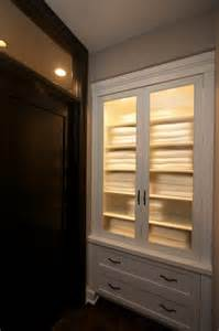 Robeson design built in hallway closet towel storage and linen