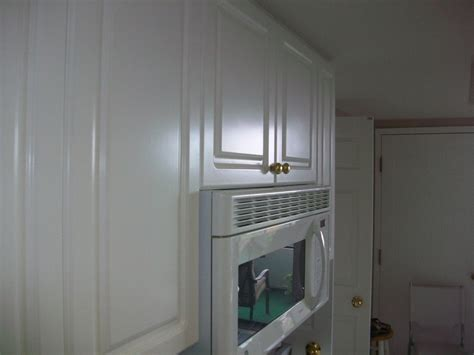 repainted kitchen cabinets kitchen cabinet repainting clean state painting