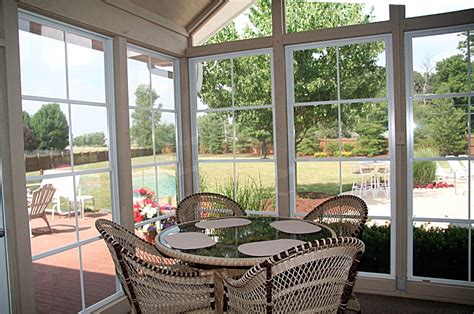 Closed In Patios by Dining Area Mixed With A Sunroom