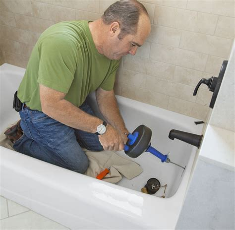 How To Unclog Plumbing by Tackle A Draining Bathtub This House
