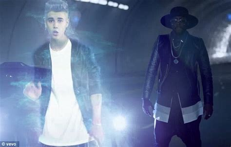 justin bieber makes holographic appearance in will i am s