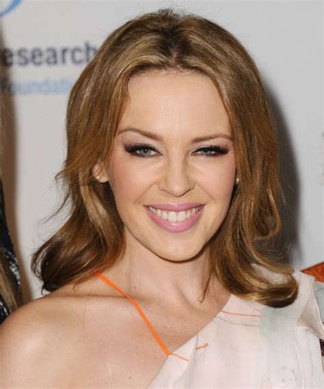 casual chignon updo hairstyle for women kylie minogue hairstyle kylie minogue medium straight casual hairstyle dark