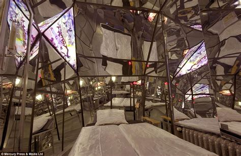 room covered in mirrors is this the world s weirdest hotel propeller island city lodge boasts a prison cell and coffin