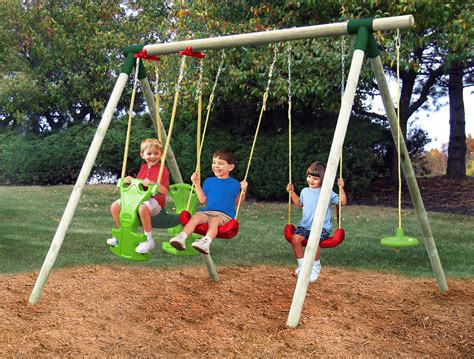 swinging on a swing set swing sets garden sports