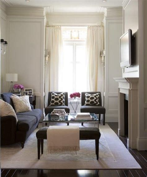 black and ivory living room chic living room design with ivory paneled walls ivory silk drapes lucite sconces ivory rug