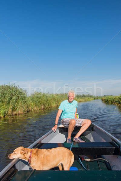 motor boat dog senior man with dog in motor boat stock photo 169 ivonne