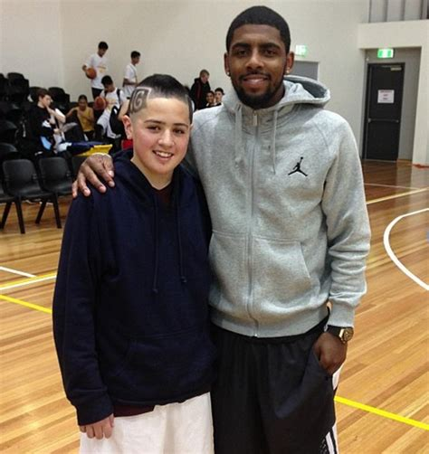 fan kyrie irving s name into his hair larry brown
