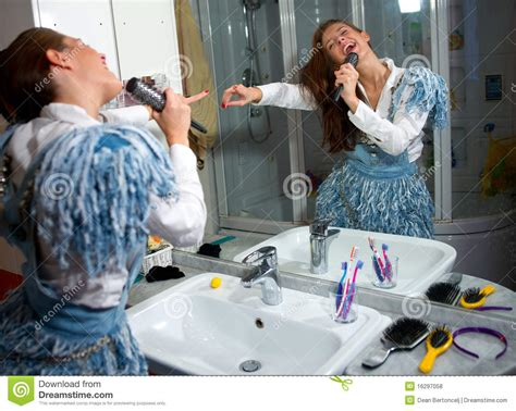 singing in bathroom teen girl singing stock photo image of mirror screeming