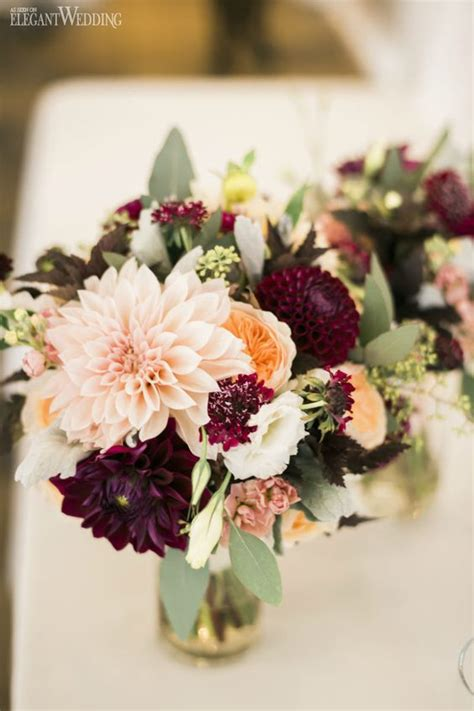 burgundy wedding centerpieces roses rings