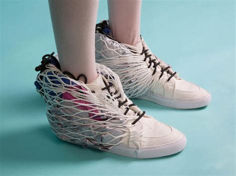 designboom shoes mobile shelter pops out of a pair of sneakers