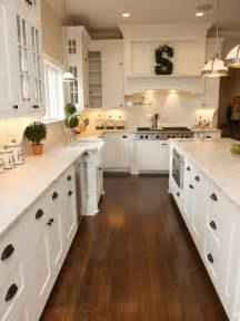 Hardwood Floor In Kitchen White Kitchen Shaker Cabinets Hardwood Floor Black Pulls For The Home Shaker