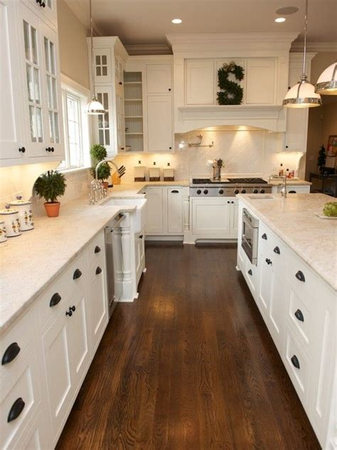 Wood Floor In Kitchen White Kitchen Shaker Cabinets Hardwood Floor Black