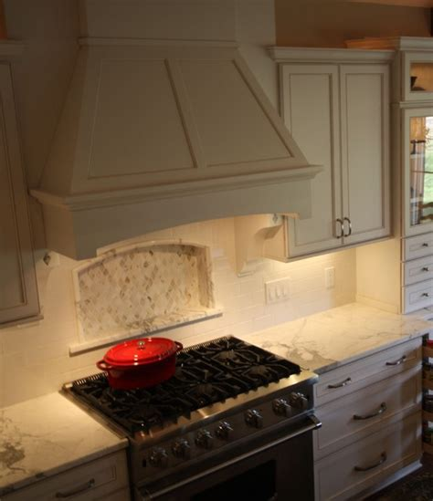 How To Build Rustic Kitchen Cabinets - wood range hood traditional kitchen cleveland by architectural justice