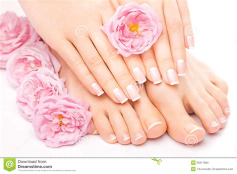 Manicure And Pedicure pedicure and manicure with a pink flower stock photo
