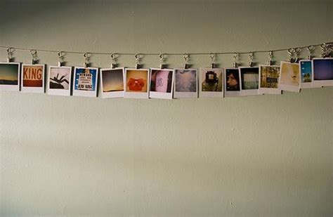 hanging photo display display ideas polaroid on a string more apartment therapy