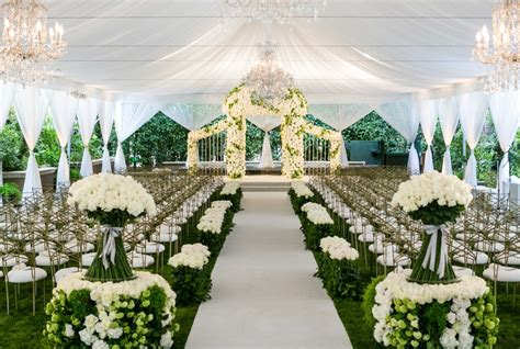 ceremony decor  elegant white green tent