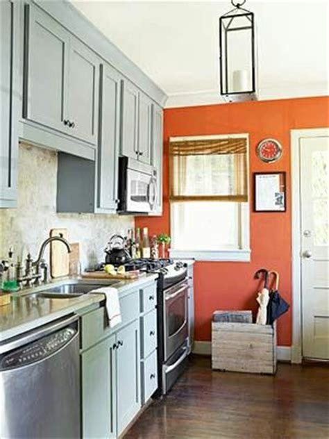 how to tone down orange cabinets contrasting color scheme blue gray burnt orange cool