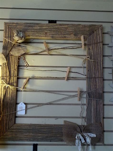 in framed rustic barn wood made into a picture frame with twine